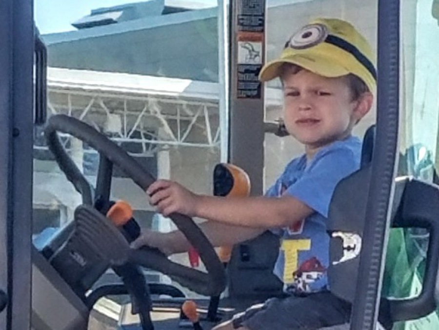 Brian Thielges's son on a tractor on the farm